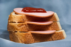 Russian sandwich. With sausage on blue background Stock Photo
