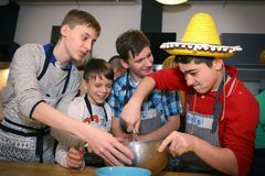 Russian school boys team on cooking party event