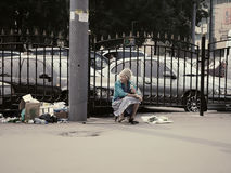 Russian seniors - poorly dressed old woman at street hawkering near garbage. Russia - Moscow - poorly dressed old woman at street hawkering near garbage Royalty Free Stock Photo