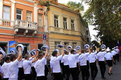 Russian ship crew members greeting. The crew members of the Russian tall ship Kruzenshtern marching and greeting the people on Varna city street during the SCF Royalty Free Stock Image