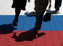 Russian shoppers. Silhouetted pedestrians overlaid with Russian flag Stock Photography