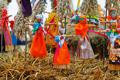 Russian Shrovetide small dolls in traditional colorful dresses on the occasion of the arrival of spring. Moscow, Russia - March 12, 2016: Russian Shrovetide Stock Images