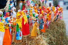 Russian Shrovetide small dolls in traditional colorful dresses on the occasion of the arrival of spring. Moscow, Russia - March 12, 2016: Russian Shrovetide Royalty Free Stock Photo