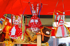 Russian Shrovetide small dolls in traditional colorful dresses at Russian national festival `Shrove` in Moscow Stock Image