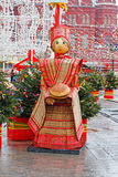 Russian Shrovetide statue in traditional colorful dress with a loaf at Russian national festival `Shrove` in Moscow Stock Photos