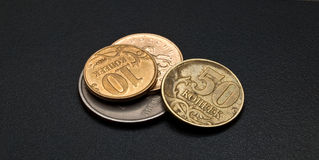 Russian small change. Some modern russian copeck coins on the dark back Royalty Free Stock Photography