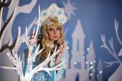 Russian Snow Maiden in blue suit and kokoshnik Stock Photo
