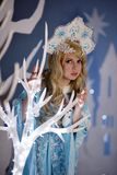 Russian Snow Maiden in blue suit and kokoshnik Royalty Free Stock Photography