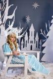 Russian Snow Maiden in blue suit and kokoshnik Stock Photos