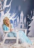 Russian Snow Maiden in blue suit and kokoshnik Royalty Free Stock Photo
