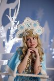 Russian Snow Maiden in blue suit and kokoshnik Royalty Free Stock Images