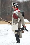 Russian soldier clean a jackboot. RUSSIA, APRELEVKA - FEBRUARY 7: Unidentified Russian soldier clean a jackboot on reenactment of the Napoleonic maneuvers near Stock Photos