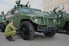 The Russian soldier prepares the Tiger armored car for a rehearsal of a military parade in honor of the Victory Day Stock Image
