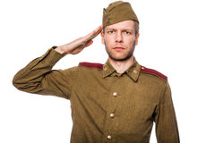 Russian soldier saluting. Second world war russian soldier saluting. Studio portrait isolated on white background Royalty Free Stock Photography