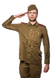 Russian soldier saluting. Second world war russian soldier saluting. Studio portrait isolated on white background Royalty Free Stock Image