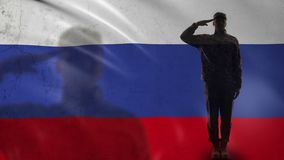 Russian soldier silhouette saluting against national flag, country defense. Stock footage stock video footage