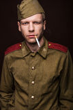 Russian soldier smoking cigarette Stock Photography