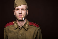 Russian soldier smoking cigarette Royalty Free Stock Images