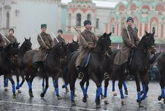 Russian soldiers- cavalry in the form of the Great Patriotic War at the parade on Red Square in Moscow. Stock Photos