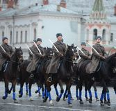 Russian soldiers- cavalry in the form of the Great Patriotic War at the parade on Red Square in Moscow. Royalty Free Stock Photos