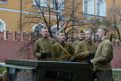 Russian soldiers prepare to parade in Red Square in Moscow. Stock Photos