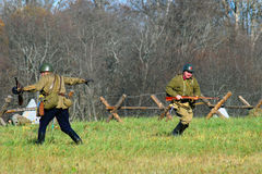 Russian soldiers-reenactors attack Stock Image