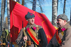 Russian soldiers-reenactors hold a reg flag Stock Images