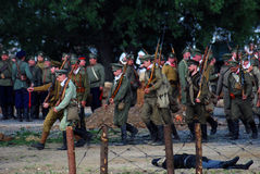 Russian soldiers-reenactors march with guns. Royalty Free Stock Photo