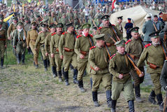 Russian soldiers-reenactors march with guns. Stock Image