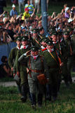 Russian soldiers-reenactors march with guns. Royalty Free Stock Image