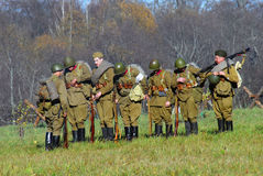 Russian soldiers-reenactors stand with guns Royalty Free Stock Photos