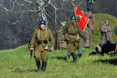 Russian soldiers-reenactors walk on the battle field. Royalty Free Stock Photography