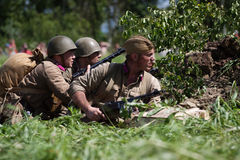 Russian soldiers in a trench. GATCHINA, RUSSIA - JUNE 30, 2012: Russian soldiers hiding in a trench during historical reenactment of WWII on June 30, 2012 in Royalty Free Stock Photography