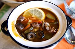 Russian soljanka soup. Traditional hot winter soup - in a small one-portion pot Stock Photo