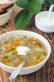 Russian soup rassolnik with sour cream Royalty Free Stock Photo
