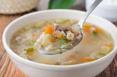 Russian soup rassolnik, spoon of soup closeup Stock Image