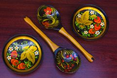 Wooden spoons and plates painted under khokhloma Royalty Free Stock Photo
