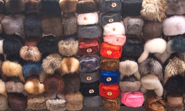 Russian souvenir fur hats with Soviet attributes Royalty Free Stock Photography