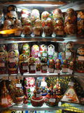 Russian Souvenirs for sale to tourists in the window of Gostiny Dvor on Nevsky Prospekt - main tourist street of St. Petersburg. The russian folk dolls Royalty Free Stock Images