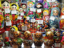 Russian Souvenirs for sale to tourists in the window of Gostiny Dvor on Nevsky Prospekt - main tourist street of St. Petersburg. The russian folk dolls Stock Image