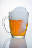 Russian Soviet beer mug. With the drip of foam. Russian Soviet beer mug. With droplets of condensate, with a cap of foam and the drip foam. Such beer mugs were Royalty Free Stock Photo