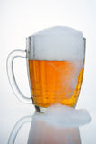 Russian Soviet beer mug. With the large drip of foam. Russian Soviet beer mug. With droplets of condensate, with a cap of foam and a large drip foam. Such beer Royalty Free Stock Image