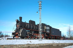 Russian and Soviet steam locomotive `Er-788-81` - a monument at the railway station of the Sortavala city. Karelia. SORTAVALA, RUSSIA - FEBRUARY 18, 2017 royalty free stock photography