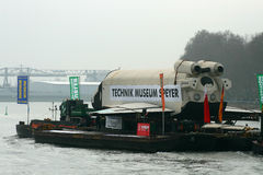 Russian Space Shuttle. The russian space shuttle Buran is transported over the river Rhine from Rotterdam to the technical museum in Speyer,Germany. Shot from 04 Stock Photos