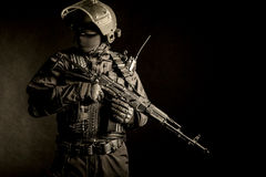 Russian special forces. Operator in black uniform and bulletproof helmet Stock Photo