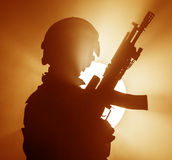 Russian special forces operator. In bulletproof helmet in the smoke and fire royalty free stock images