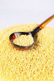 Russian spoon with millet groats Stock Photo
