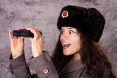 Russian spy looking through binoculars Royalty Free Stock Photography