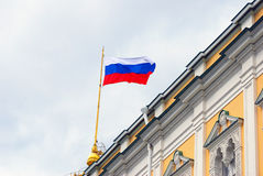 Russian state flag in Moscow Kremlin. View of the Russian state flag tricolor in Moscow Kremlin, a popular touristic landmark. UNESCO World Heritage Site royalty free stock images