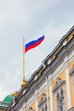 Russian state flag in Moscow Kremlin. View of the Russian state flag tricolor in Moscow Kremlin, a popular touristic landmark. UNESCO World Heritage Site stock photos